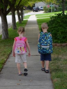 Back to school backpacks siblings