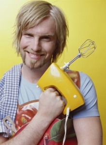 Young man holding mixer